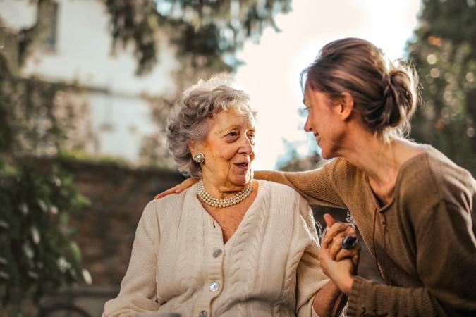 joyful-adult-daughter-greeting-happy-surprised-senior-mother-3768131